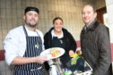 Chef Orry Shand and Lyla Munro from Entier with Mike Burns, chief executive of Aberdeen Cyrenians. Picture by Paul Glendell.