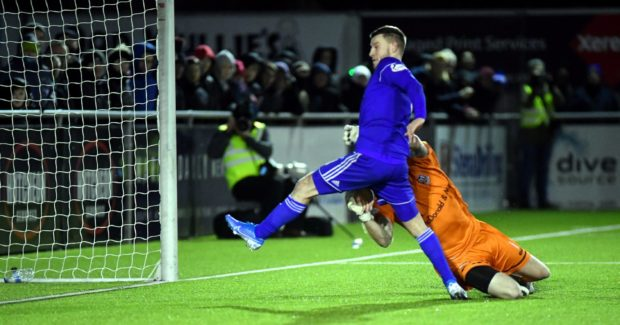 Cove's Mitchel Megginson beats Elgin keeper Thomas McHale to get the second.. Picture by Chris Sumner