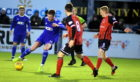 Cove Rangers midfielder Jamie Masson in action against Elgin City.