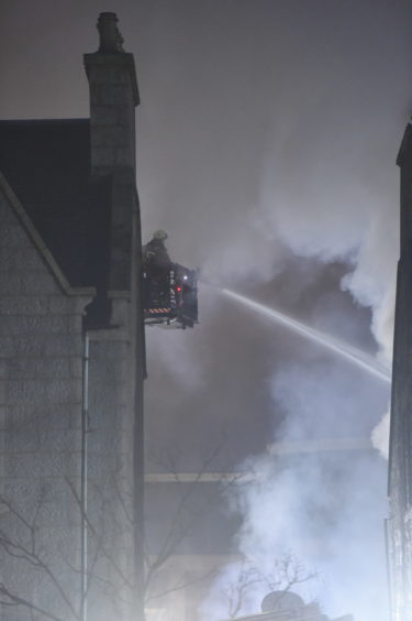 Fire crews using jets to extinguish the fire at Valentinos Italian Restaurant.