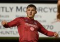 Brora's James Wallace celebrates scoring.