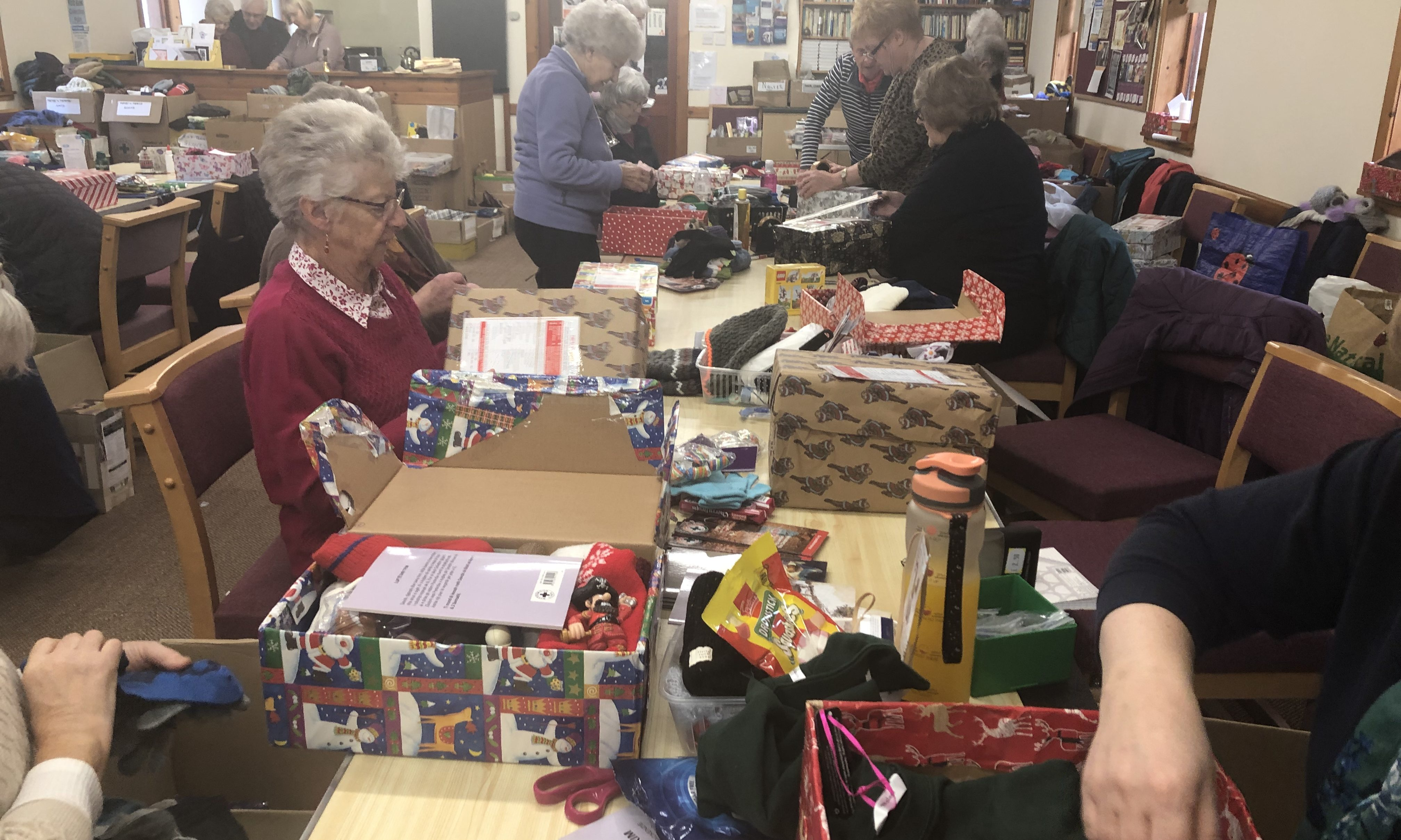 Volunteers at Maryburgh Free Church sort through boxes to ensure they are appropriate