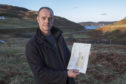 Kris Scott with his site plans for a cleaning pod at Durness, near Smoo Cave.