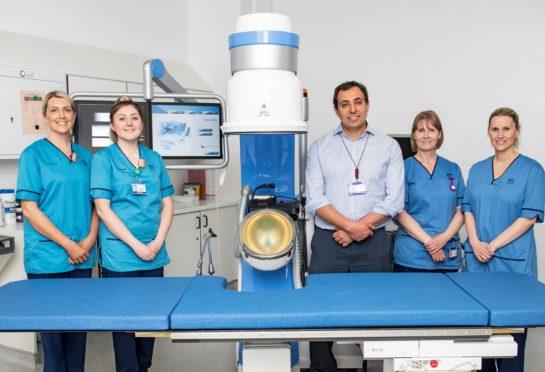 From left: Laura Slater(lithotripsy lead radiographer), Catriona MacGillivray (lithotripsy specialist radiographer),  Ismail Mokadem, (consultant urologist), Jackie Reid (staff nurse) and Lynn Rankin (staff nurse)