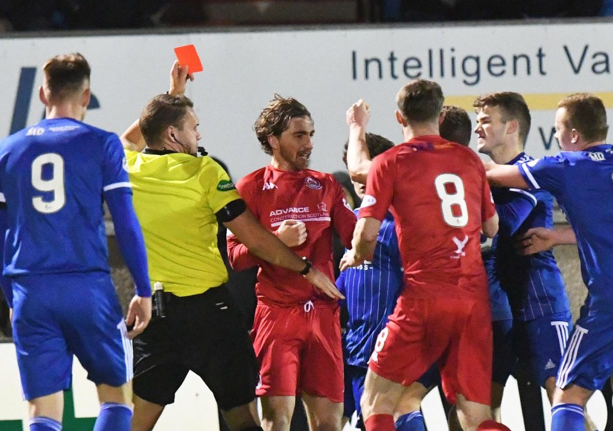 REFEREE CHRIS GRAHAM SHOWS RED TO SIMON FERRY
