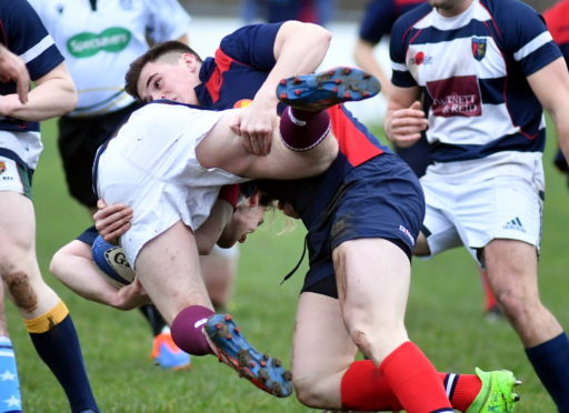 Select's Sean Mills gets to grips with Exiles' Stuart Niven. Picture by Chris Sumner