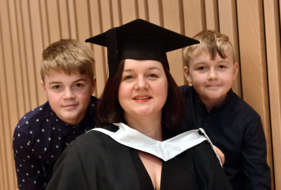 RGU Winter Graduations at Music Hall, Aberdeen Pictured is Charlotte McLean with her sons from left Callum, 14 and Ioan, 10 (Corr). MSc Data Science An Aberdeen-based mature student has reignited her passion for data after heading back into education to complete a Master's Degree in Data Science at RGU. Charlotte McLean (45), who is originally from Cardiff, lost her job during the oil crash and found herself commuting to Edinburgh for a role which lasted over three years. She then made the choice to go back to university to give her the opportunity to enhance her skills with a view to gaining a role in the city she and her family had settled in. North-East  Picture by DARRELL BENNS  Pictured on 11/12/2019    CR0014966