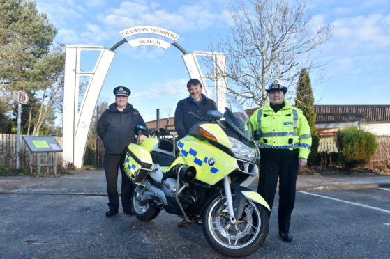 Pictured are from left, Superintendent Stewart Mackie from Police Scotland,  Mike Ward MBE, Curator, Grampian Transport Museum and Superintendent Louise Blakelock.  A Police motorcycle was donated to Grampian Transport Museum, Alford. The 'retired' motorcycle, a 2009 BMW R1200RT, has reached the end of its service with the Road Policing Unit and will join an ex-Grampian Police 1985 Rover SD1 Vitesse that is already on display at the museum.  Picture by DARRELL BENNS  Pictured on 16/12/2019    CR0017601 / CR0017539