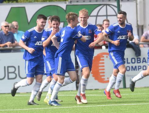 Cove players celebrate Harry Milne's goal against Edinburgh City.
