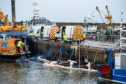 The Pegasus is pictured submerged in Buckie Harbour.   Pictures by JASON HEDGES