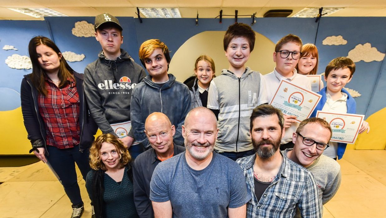 Management are pictured with students L2R front - Nicola Kennell (Art Therapist), Tim Flood (Film Maker), Steve Gasgarth (In the mix Project Coordinator Findhorn Bay Arts), Dave Martin (musician) Gary Collins (out of the darkness theatre company and drama  Pictures by JASON HEDGES