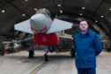 Pictures by JASON HEDGES URN: CR0017235   Pictures show RAF Lossiemouth and the QRA facility at the base. Picture: Senior Chaplin, Wing Commander Rev. Colin Weir is pictured at an armoured shelter with an RAF Typhoon in the background. Pictures by JASON HEDGES
