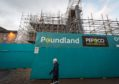 Scaffolding surrounding Poundland in Elgin.   Pictures by JASON HEDGES