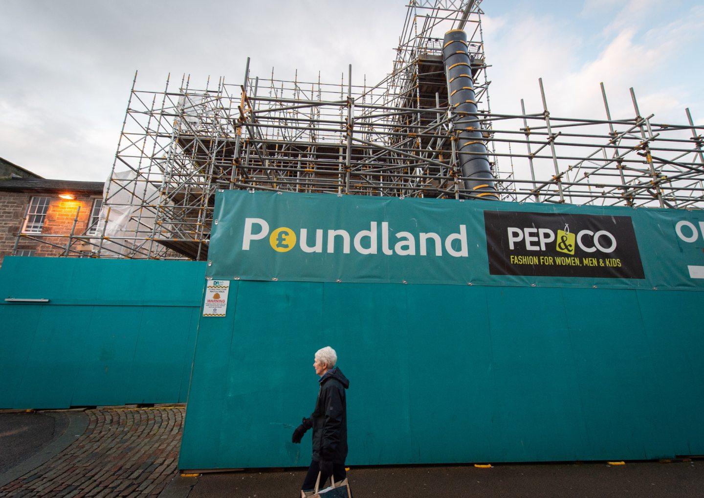 Scaffolding surrounding Poundland in Elgin.