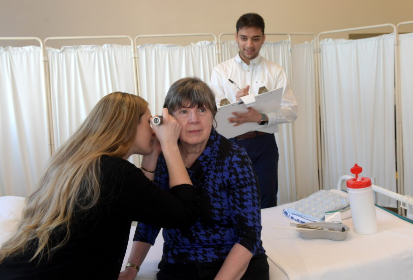 Volunteer patient Liz Ritchie is pictured with students Lorna Patrick and Rafsan Chowdhury. Picture by KATH FLANNERY