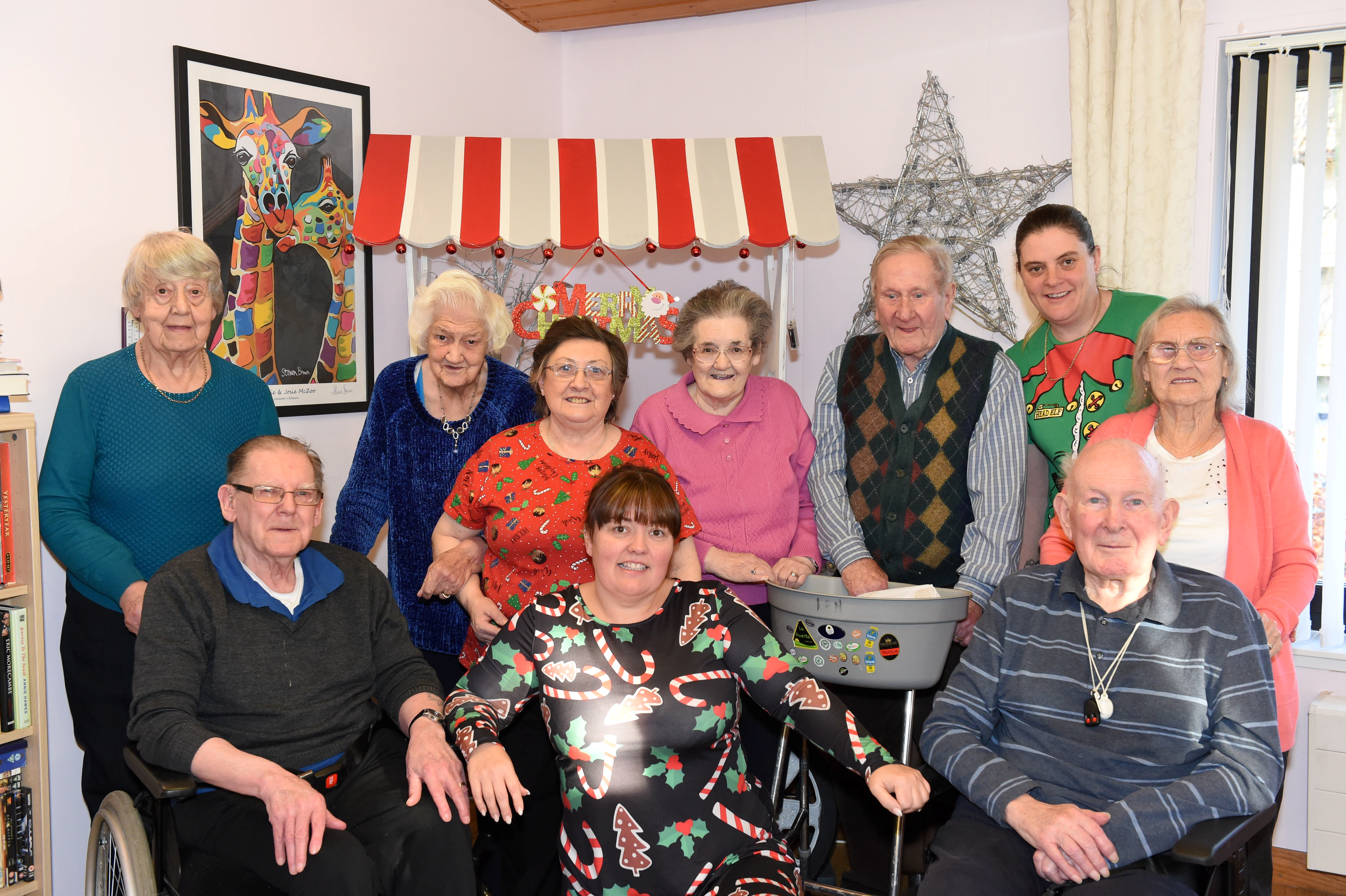 Craigton Road Day Centre is one of the groups hoping to win the P&J minibus competition  Pictured are service users at the centre with Paulene Monaghan ( Service Manager ) at centre of the photo Picture by Paul Glendell