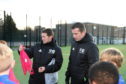Performance School coaches Derek Young and Stuart Glennie prepare to start the session at Hazlehead Academy.