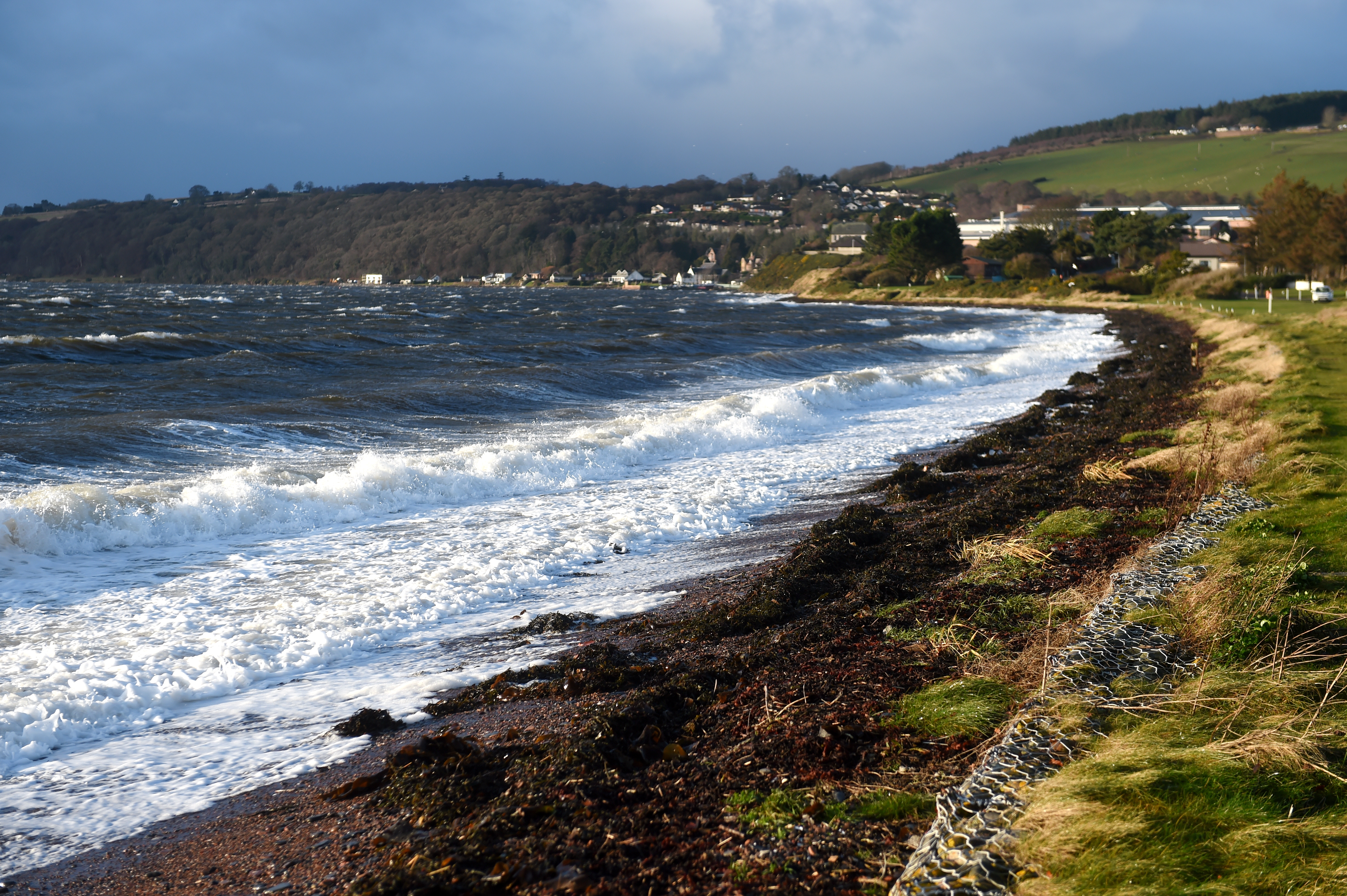 Stormy seas with a strong south west gale batter the shoreline  of the Inverness Firth at Fortrose on the Black Isle.