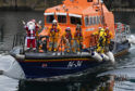 SANTA ARRIVES IN THE BROCH ON THE LIFEBOAT.