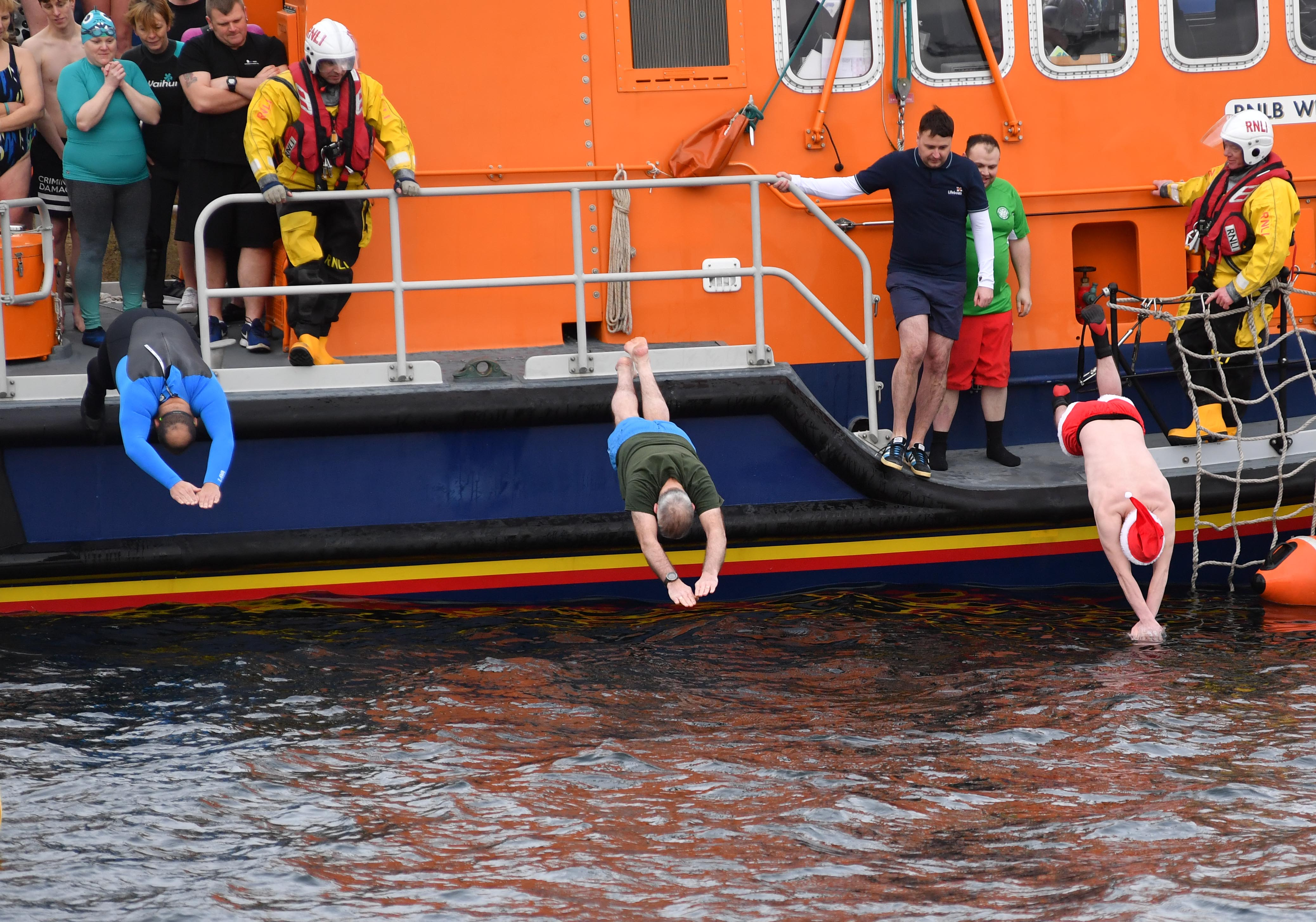 Swimmers brave the low temperature for the Boxing Day swim across Fraserburgh harbour in aid of the RNLI.