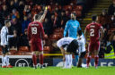 Aberdeen's Joe Lewis is booked by referee Steven McLean during the Ladbrokes Premiership match between Aberdeen and St Mirren at Pittodrie.