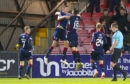 Ross Stewart celebrates scoring with his Ross County teammates.