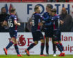 Ross Stewart is congratulated by team-mates after scoring against Hibernian.