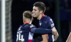 Ross County forward Ross Stewart, right.