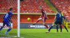 Sam Cosgrove volleys in at the back post for Aberdeen against Hamilton.