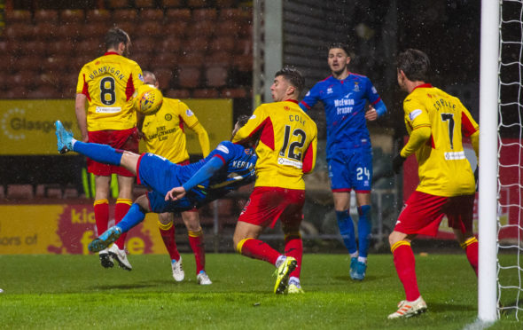 Inverness' James Keatings scores an acrobatic goal