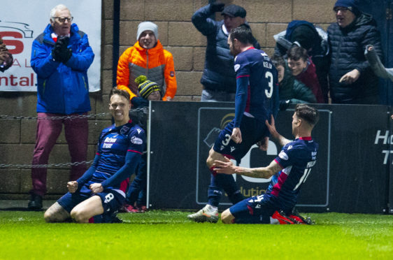 Ross County's Lee Erwin celebrates after scoring to make it 1-0 during the Ladbrokes Premiership match between Ross County and Kilmarnock.