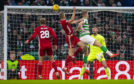 Sam Cosgrove scores the equaliser during a Ladbrokes Premiership match between Celtic and Aberdeen.