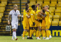 Lyndon Dykes is mobbed by his Livingston team-mates en-route to his hat-trick against Ross County.