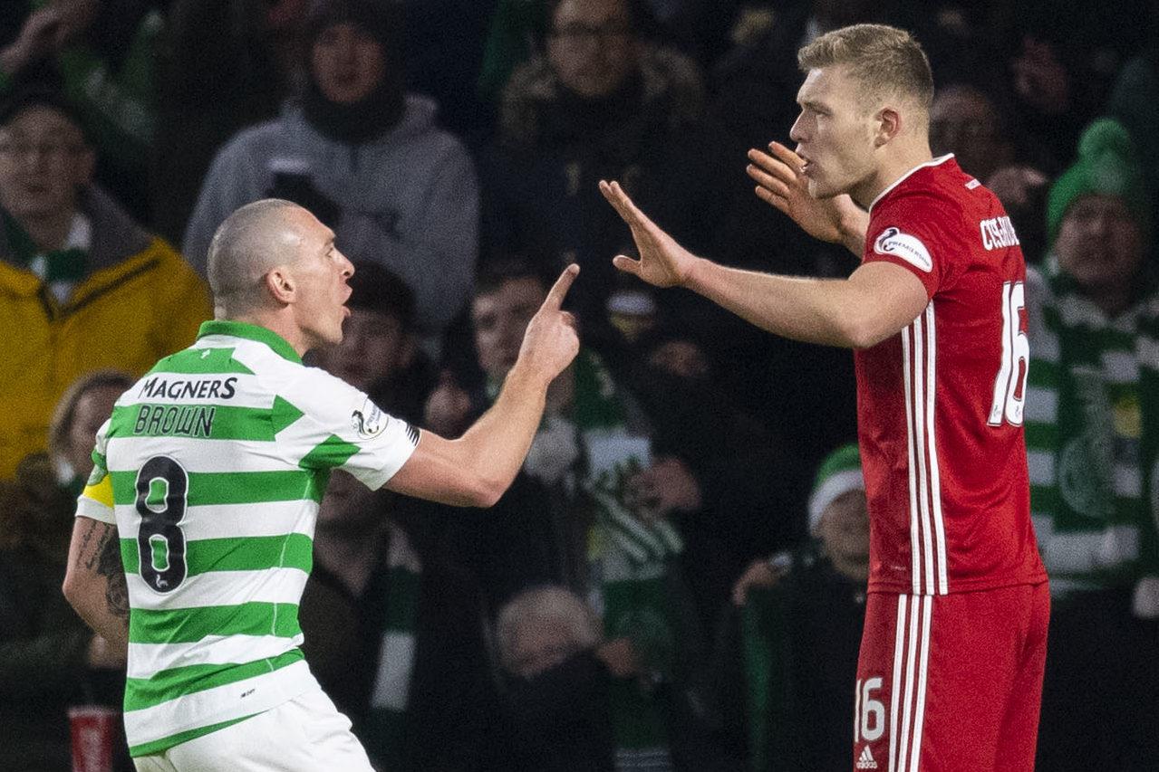 Celtic's Scott Brown and Aberdeen's Sam Cosgrove exchange words.
