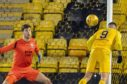 Livingston's Lyndon Dykes secures his hat-trick with a diving header during a Ladbrokes Premiership match between Livingston and Ross County.