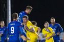 Inverness's Jamie McCart (6) rises to head in the second goal during a Ladbrokes Championship match between Inverness Caledonian Thistle and Dunfermline Athletic
