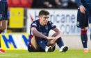 Ross County's Ross Stewart (centre) goes down injured during a Ladbrokes Premiership match between St Johnstone and Ross County.