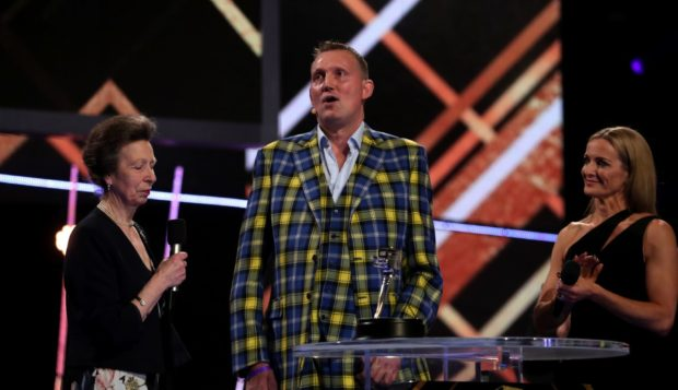 Doddie Weir (centre) receives the Helen Rollason Award from The Princess Royal during the BBC Sports Personality of the Year 2019 at The P&J Live, Aberdeen. PA Photo. Picture date: Sunday December 15, 2019. See PA story SPORT Personality. Photo credit should read: Jane Barlow/PA Wire.