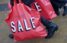 Sale shoppers hit the streets on Boxing Day. Picture by Sandy McCook.