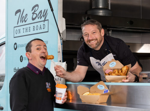 Calum Richardson from The Bay Fish and Chips and Findlay Leask from Caber Coffee who will be raising funds for CFINE by selling pigs in blankets, fish and chips, and coffee in Aberdeen city centre.