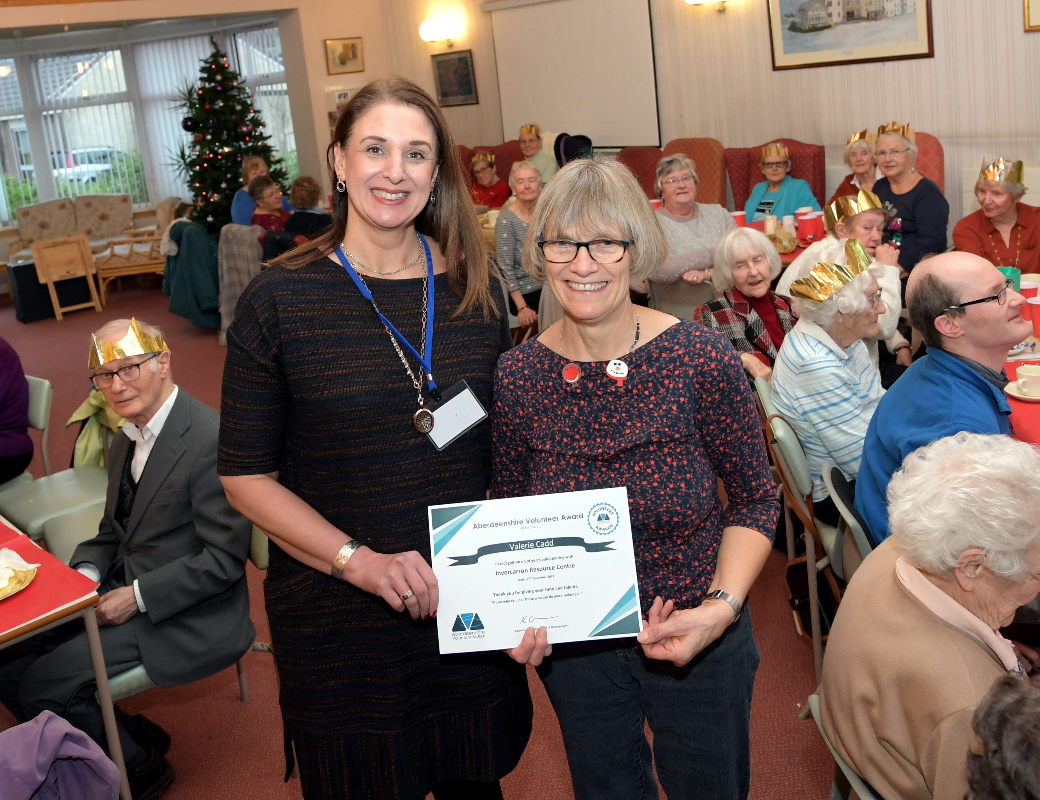 Val receives her award from Sandra McGuigan