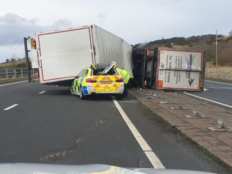 The police car was partially crushed by the lorry