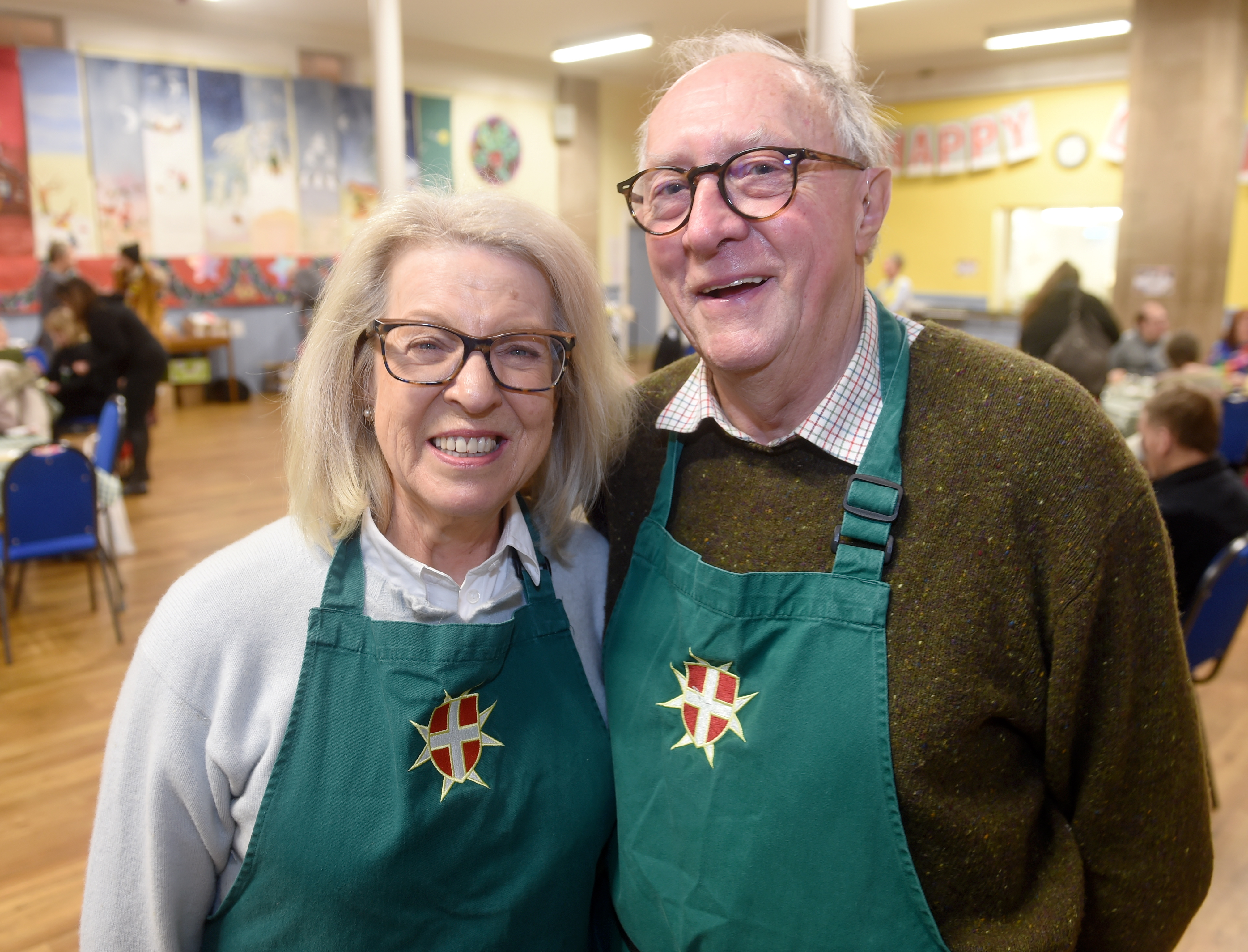 Companions of the Order of Malta Godfrey and Claire Macdonald help out with  the homeless and needy attending Inverness Foodstuff for a free warm meal at Ness Bank Church Hall in Inverness. Pictures by Sandy McCook