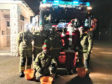 Portsoy Fire crew with their decorated engine and Santa