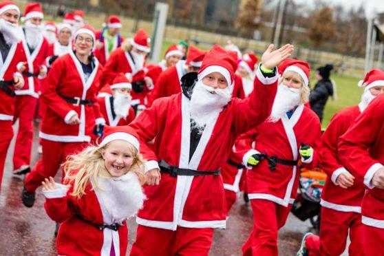 Runners dressed as Santa take part in a Santa Fun Run at the Inverness Campus.