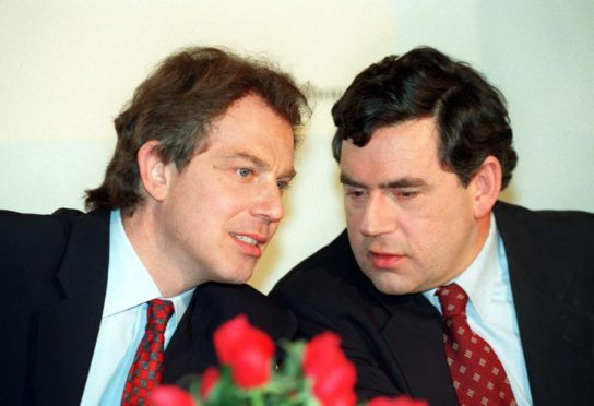 From the archives: Labour leader Tony Blair listens attentively to shadow Chancellor Gordon Brown
