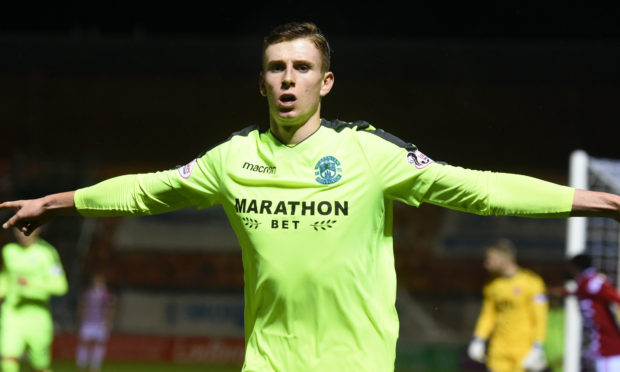 Oli Shaw celebrates netting for Hibernian.