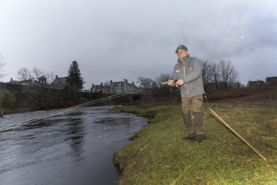 Freddie Sutherland, from Uddingston, casts the first fly of the new salmon season, on Thurso River.