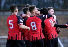 Elgin's second goalscorer Kane Hester hidden amongst celebrating team-mates.