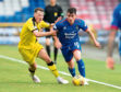 Inverness's Aaron Doran in action with Raith Rovers' Regan Hendry